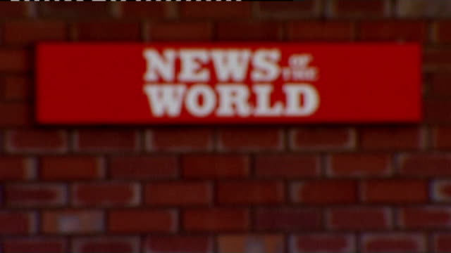 news of the world phone hacking scandal: news of the world paper to close; england: london: wapping: ext 'news of the world' sign outside wapping... - news of the world stock-videos und b-roll-filmmaterial