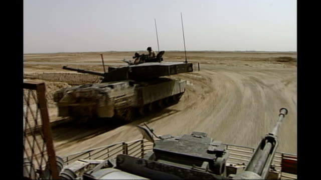 stockvideo's en b-roll-footage met news of the world paper to close afghanistan ext british military tanks along desert road british troops along desert road towards waiting chinook... - news of the world