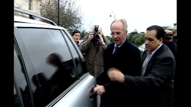 news of the world phone hacking scandal: news of the world paper to close; ext sven goran eriksson into car as surrounded by press photographers - news of the world stock-videos und b-roll-filmmaterial
