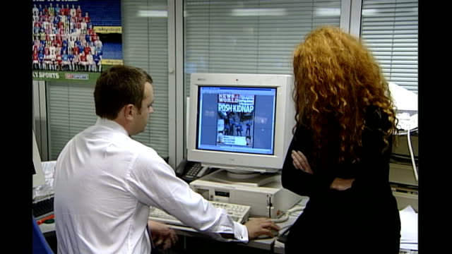 news of the world phone hacking scandal: news of the world paper to close; tx 3.11.2002 andy coulson and rebekah brooks sitting at desk looking at... - news of the world stock-videos und b-roll-filmmaterial