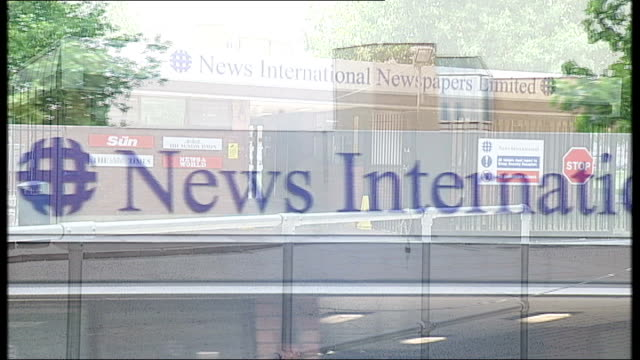 news of the world phone hacking scandal: news of the world paper to close; news international wapping headquarters and sign over entrance - news of the world stock-videos und b-roll-filmmaterial