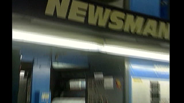 news of the world phone hacking scandal: news of the world paper to close; 2000 'news of the world' newspapers along on printing press pull out copy... - petition stock videos & royalty-free footage