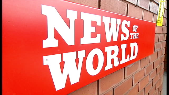 news of the world phone hacking scandal: news of the world paper to close; england: london: wapping: ext 'news of the world' sign outside factory - news of the world stock-videos und b-roll-filmmaterial