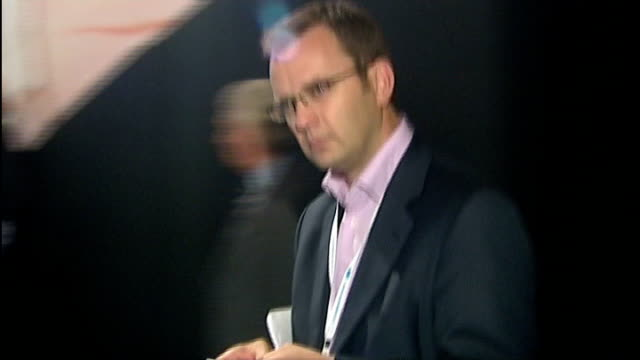 stockvideo's en b-roll-footage met news of the world paper to close october 2007 andy coulson along as looking at mobile phone - news of the world