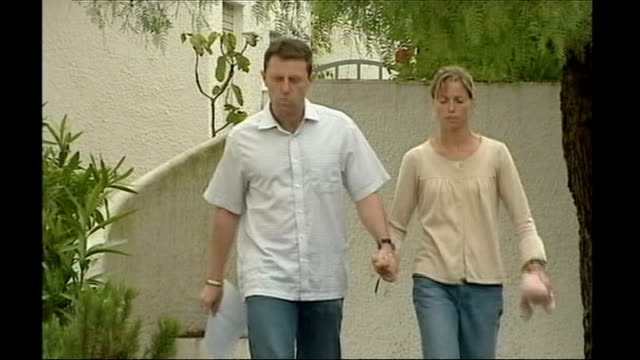 news of the world phone hacking scandal / police officers paid by news international t26050716 algarve praia da luz gerry mccann and kate mccann walk... - kate mccann stock videos & royalty-free footage