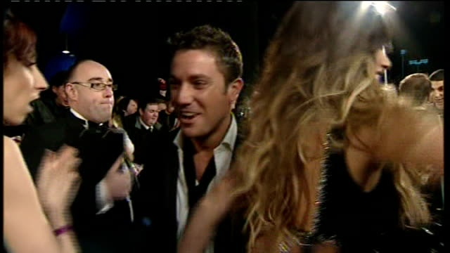 police reopen investigation england london arrivals at national television awards including chris tarrant gina d'acampo max clifford interview sot... - 盗聴点の映像素材/bロール