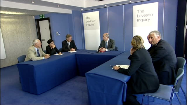 public inquiry members declare connections england london int judge leveson and other members of leveson inquiry sitting at table lord justice... - conference phone stock videos & royalty-free footage