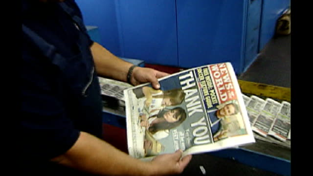 rebekah brooks resigns / rupert murdoch meets with dowler family t05080001 copy of news of the world held by print worker with headline thank you... - レベッカ ブルックス点の映像素材/bロール