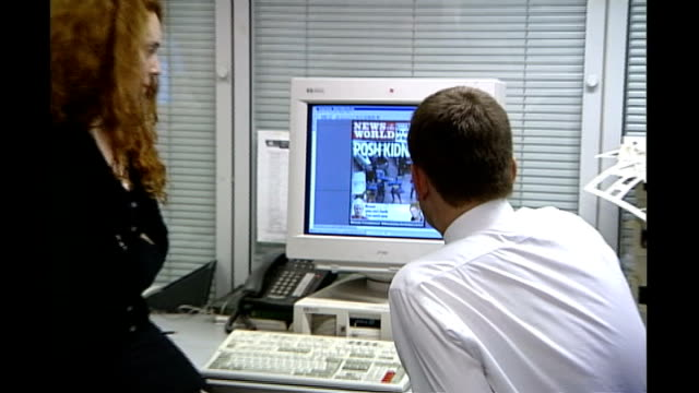 rebekah brooks resigns / rupert murdoch meets with dowler family r03110201 wapping int andy coulson and brooks sitting at computer with headline... - レベッカ ブルックス点の映像素材/bロール