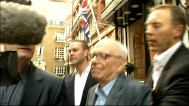 rebekah brooks resigns / rupert murdoch meets with dowler family t14071101 murdoch from building with son james murdoch as jostled by press - rupert murdoch stock videos and b-roll footage