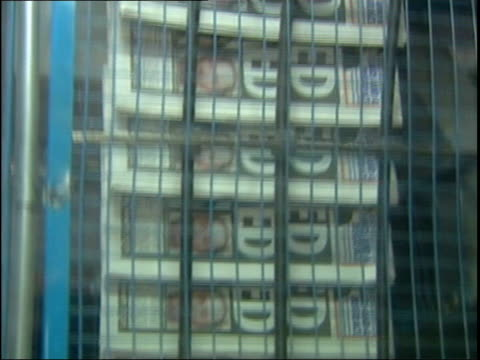 news of the world printing press in operation tilt up itn redcar: ext flowers outside hartley's house with 'god bless x' card attached flowers in... - b rolle stock-videos und b-roll-filmmaterial
