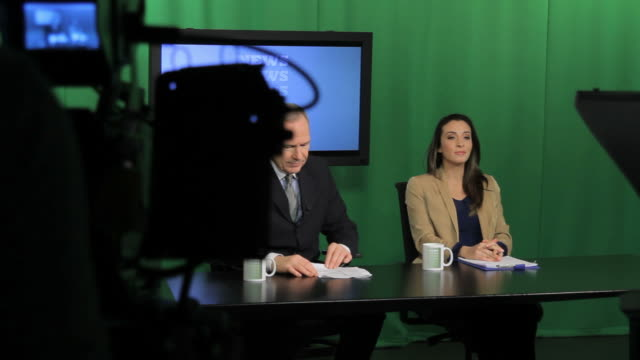 news presenters broadcasting - presenter stock videos & royalty-free footage