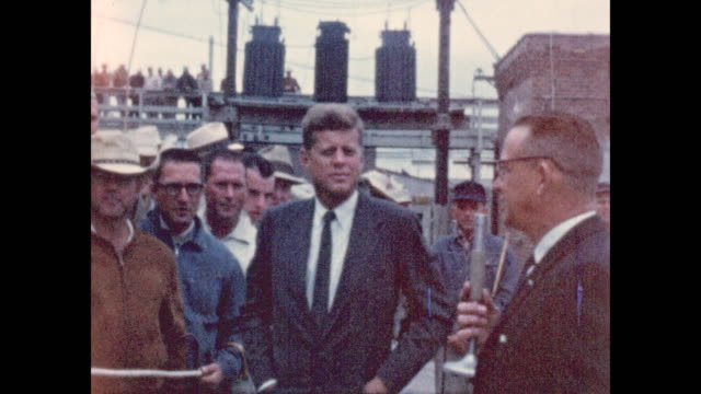of news reporter as john f. kennedy campaigns for his presidency at the sioux city, iowa stockyards in 1959. jfk shakes hands with supporters and... - john f. kennedy us president stock videos & royalty-free footage