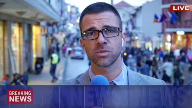 News reporter live broadcasting on street.