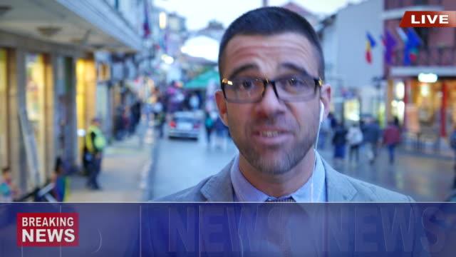 news reporter live broadcasting on street. - evento in diretta video stock e b–roll