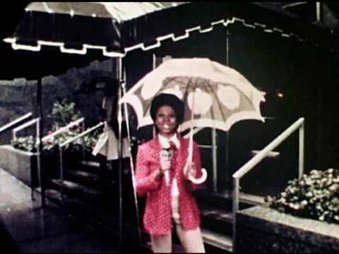 abc news reporter melba tolliver flubbing her lines as she stands outside in the rain / multiple takes - ngクリップ点の映像素材/bロール
