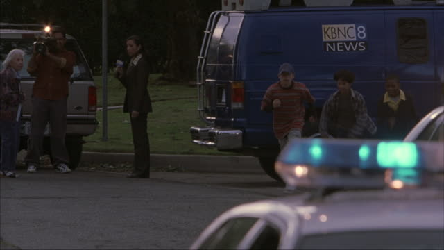 news reporters perform interviews near a police crime scene. - media interview stock videos and b-roll footage