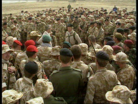 news roundup iraq major meeting troops in desert speech receives gun helmet allied pows to bus bahrain raf thanksgiving service reunited father son... - imbrancare video stock e b–roll