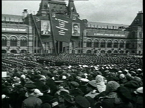 news special issue may day army parade in red square soldiers marching with machine guns spectators parade of heavy machine guns pulled by horses... - propaganda stock-videos und b-roll-filmmaterial