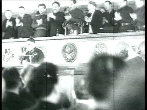 news special issue, xvii communist party of the soviet union congress, deputies alexei stetskii and oleg lobov having speech, audience applauding,... - 1934 stock-videos und b-roll-filmmaterial