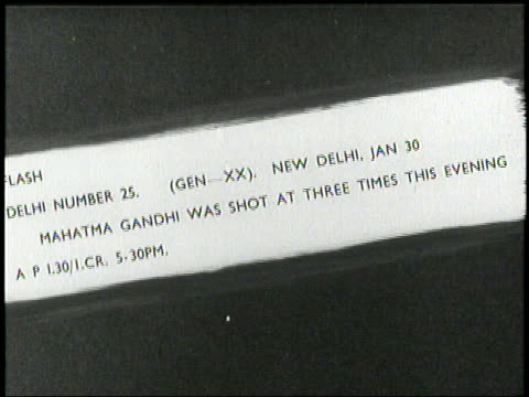 vídeos de stock, filmes e b-roll de a news ticker announces mahatma gandhi's assassination in 1948 - 1948