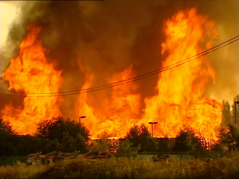 part one generics fire fire raging filling screen then with fire service in foreground billowing smoke and fire raging in field firefighters in crane... - itv news at one stock videos & royalty-free footage