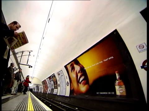 part one london holborn underground station train arriving at platform full of commuters / people waiting and getting on tube / tube train away... - itv news at one stock videos & royalty-free footage