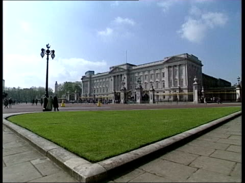 Part two ENGLAND London EXT General view of Kensington Palace General views of Buckingham Palace with traffic in foreground Royal Crest on gates...