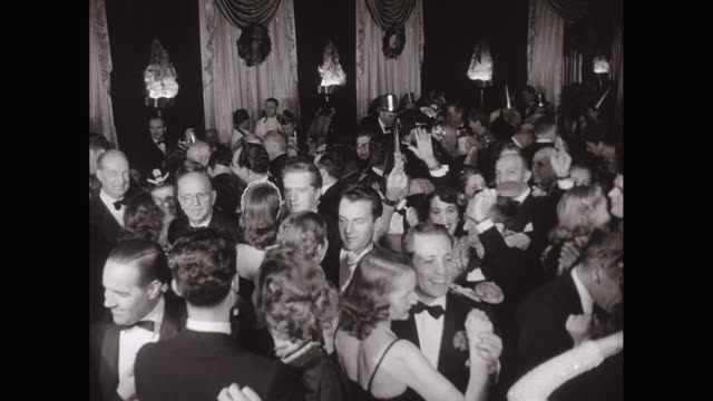 WS 1948 News Year's Eve party, people at tables wearing hats and waving party favors, couples dancing, celebrating  / United States