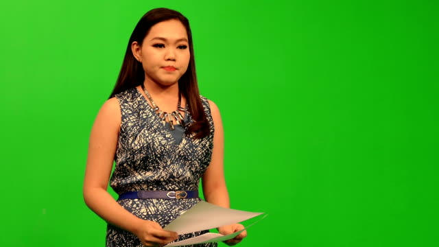 newscaster reading a news bulletin - breaking news stock videos and b-roll footage