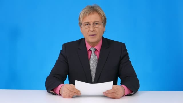4k newscaster reading the breaking news - presenter stock videos & royalty-free footage