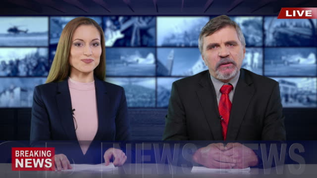 newscasters presenting the breaking news - breaking news stock videos & royalty-free footage