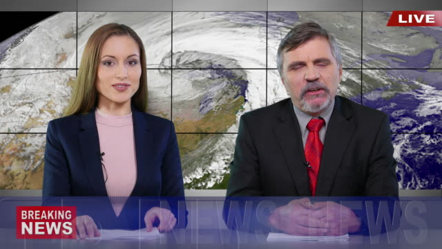Newscasters presenting the breaking news