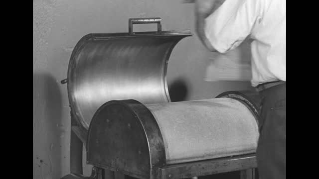 newsman enters room with row of teletype receive only printers and checks out news stories at the new york daily news / teletype machine printing,... - linotype machine stock videos & royalty-free footage