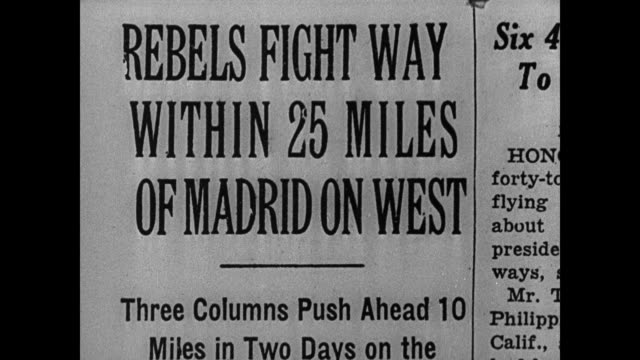 newspaper '25 miles of madrid' la ws fighter airplanes inflight ha ws civilians running across square madrid xla xws fighter airplanes over city ws... - 1937 stock-videos und b-roll-filmmaterial