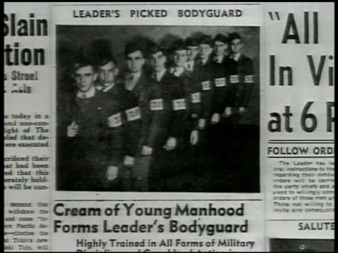 Newspaper '300 Traitors Slainfiring squad' newspaper photograph of NO Leader's Bodyguard APPROVED PICTURES Male holding children w/ ice cream cones...