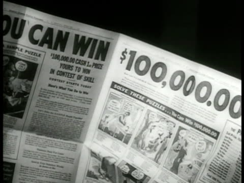 newspaper ad '$100 000 1st prize...' prize money list. boy & girl trying to solve puzzle. puzzle cartoon racist. - lotterie stock-videos und b-roll-filmmaterial