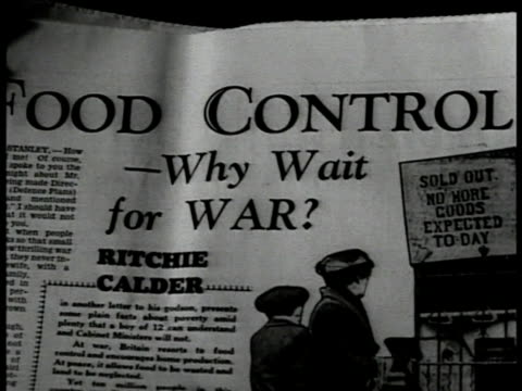 newspaper article 'food controlwhy wait for war' ext health center int health center w/ people sitting in snacking area surrounding pool - article stock videos and b-roll footage