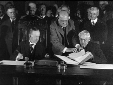 newspaper article heading 'coolidge to sign peace pact' ws us president calvin coolidge in east room of white house signing kelloggbriand peace pact... - 1928 stock videos & royalty-free footage
