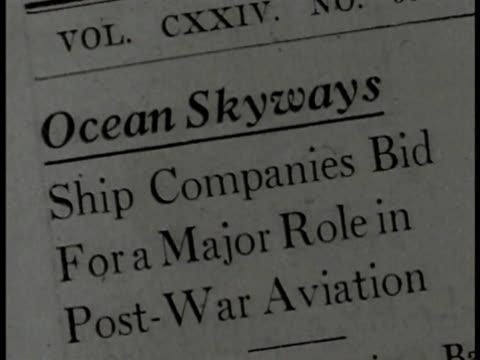 stockvideo's en b-roll-footage met newspaper article on 'ocean skyways' int meeting room w/ members of civil aeronautics board sitting at tables mr. jackson speaking from seat - artikel