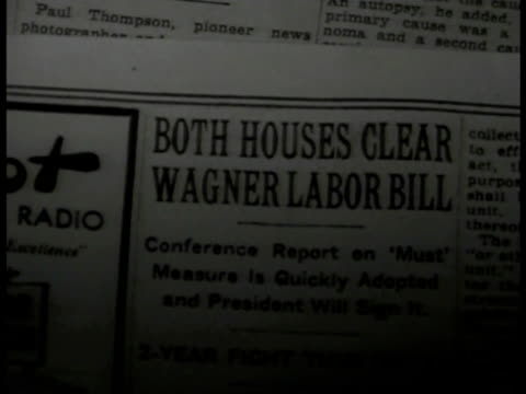 stockvideo's en b-roll-footage met newspaper 'both houses clear wagner labor bill.' int robert f. wagner standing at desk shacking hands w/ office men & women. wagner smiling... - 1935