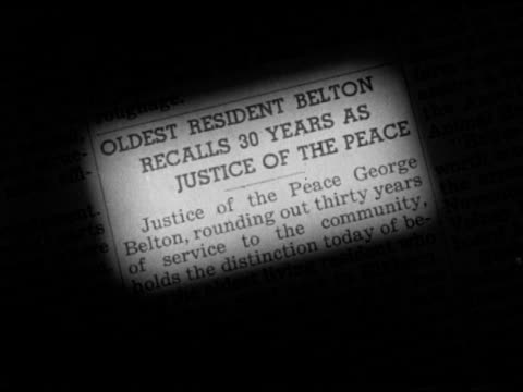 newspaper clipping highlight of justice of the peace george belton claude eames entering office building sign over entrance 'justice of the peace... - newspaper clipping stock videos and b-roll footage