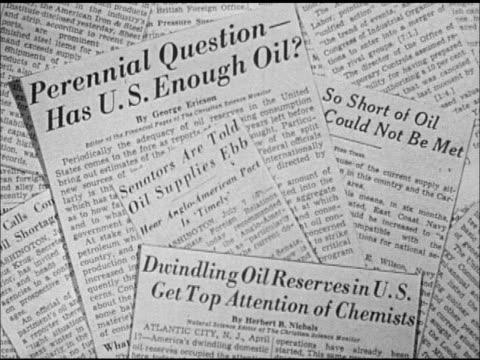 stockvideo's en b-roll-footage met newspaper clippings in pile, '...has us enough oil?', '...oil supplies ebb', 'so short of oil...', 'dwindling oil reserves...' - artikel