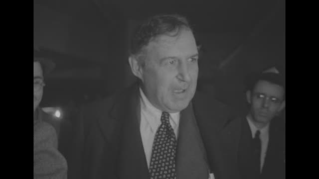 newspaper columnist heywood broun speaks emphatically to camera as he stands outside the german-american bund rally at madison square garden - columnist stock videos & royalty-free footage