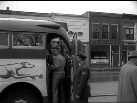 newspaper 'county youths leave for service' vs young males recruits boarding greyhound bus clerk local draft board mrs adelaide lackey w/ clipboard... - military recruit stock videos and b-roll footage