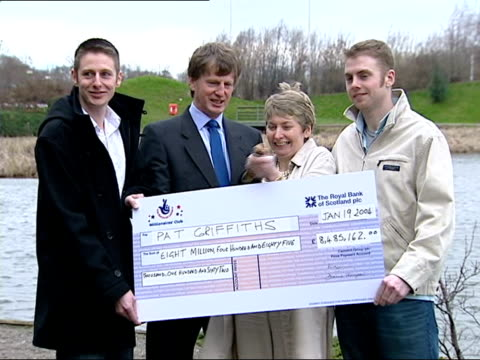 Newspaper editor wins £8 million HTV NO RESALE Lottery winner Pat Griffiths and her family posing with cheque as champagne popped CMS Griffiths...
