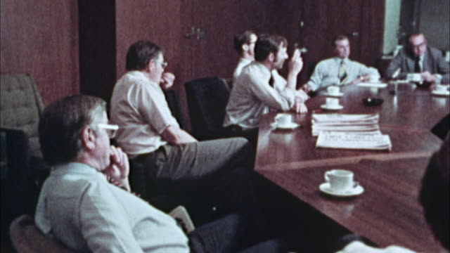 MS, DS, Newspaper editors from the Los Angeles Times in conference room, 1970's, Los Angeles, California, USA