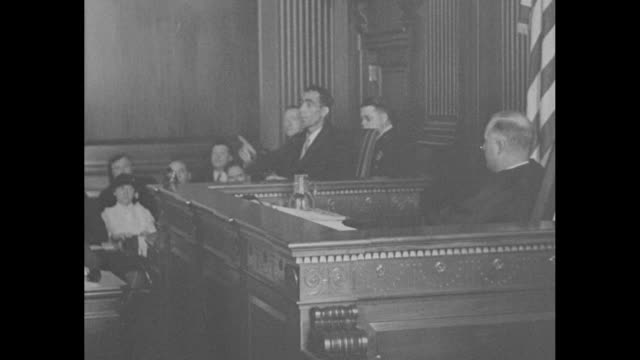 stockvideo's en b-roll-footage met hauptmann loses plea / bruno richard hauptmann and his legal staff enter the courtroom and sit at their table during his trial in the lindbergh... - table top view
