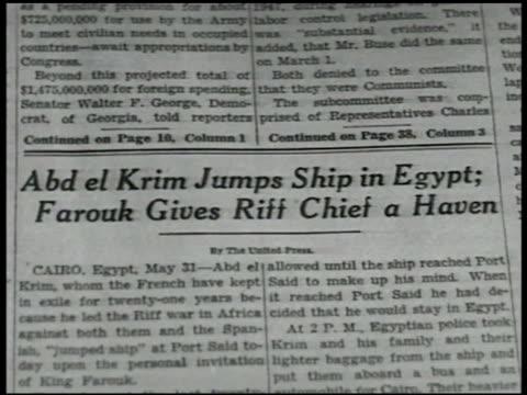 newspaper headline 'abd el krim jumpos ship in egypt farouk gives riff [sic] chief a haven' 6/8/1947 ny times cartoon abdelkrim on magic carpet photo... - riff stock videos & royalty-free footage