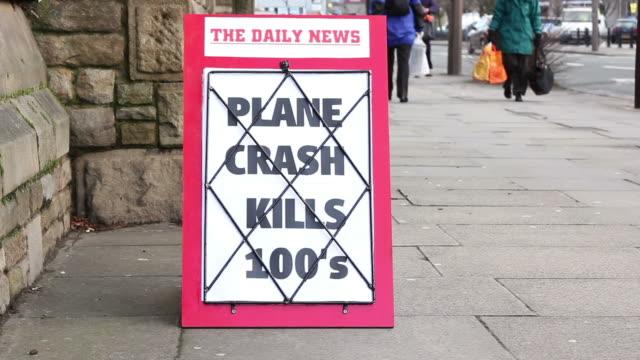 newspaper headline board - plane crash kills hundreds - newspaper headline stock videos and b-roll footage